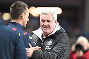 Newcastle United manager Steve Bruce  greets Aston Villa assistant manager John Terry during the Premier League match between Aston Villa and Newcastle United at Villa Park, Birmingham, England on 25 November 2019.