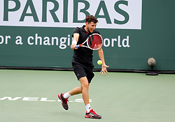 March 10, 2018 - Indian Wells, CA, U.S. - INDIAN WELLS, CA - MARCH 10: Dominic Thiem ( AUT ) hits a backhand during the second round of the BNP Paribas Open on March 10, 2018, at the Indian Wells Tennis Gardens in Indian Wells, CA. (Photo by Adam  Davis/Icon Sportswire) (Credit Image: © Adam Davis/Icon SMI via ZUMA Press)
