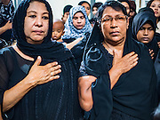 24 OCTOBER 2015 - YANGON, MYANMAR: Shia women pray and pound their chests during Ashura observances at Mogul Mosque in Yangon. Ashura commemorates the death of Hussein ibn Ali, the grandson of the Prophet Muhammed, in the 7th century. Hussein ibn Ali is considered by Shia Muslims to be the third imam and the rightful successor of Muhammed. He was killed at the Battle of Karbala in 610 CE on the 10th day of Muharram, the first month of the Islamic calendar. According to Myanmar government statistics, only about 4% of the population is Muslim. Many Muslims have fled Myanmar in recent years because of violence directed against Burmese Muslims by Buddhist nationalists.    PHOTO BY JACK KURTZ