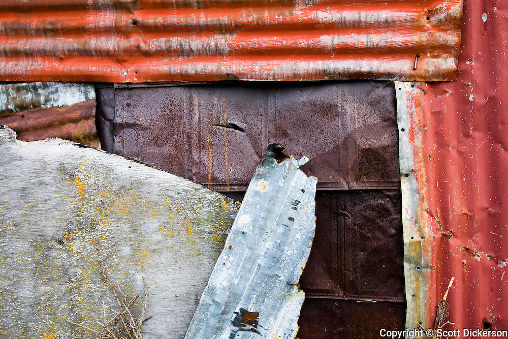 Patchwork siding on a native Alaskan's subsistence fish smoke house in Newhalen, Alaska