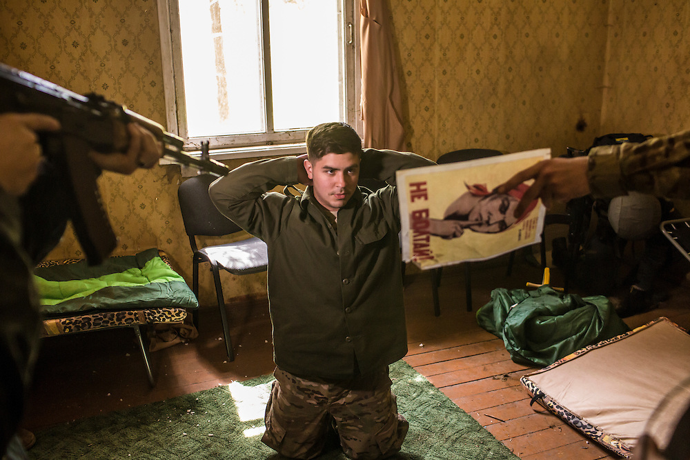 YAVORIV, UKRAINE - APRIL 30, 2015: Ukrainian soldiers simulate the interrogation of a suspect detained during a house raid, a component of military training directed by the U.S. Army's 173rd Airborne Brigade as part of Operation Fearless Guardian at the Yavoriv training center near Yavoriv, Ukraine. Around 300 American soldiers are training an equivalent number of Ukrainians during each of three eight-week programs to improve their ability to combat Russian-backed rebels in the country's east. CREDIT: Brendan Hoffman for The New York Times