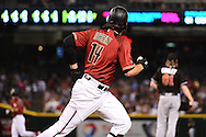 PHOENIX, AZ - JUNE 12:  Peter O'Brien #14 of the Arizona Diamondbacks hits a three run home run off Adam Conley #61 of the Miami Marlins in the first inning at Chase Field on June 12, 2016 in Phoenix, Arizona.  (Photo by Jennifer Stewart/Getty Images)