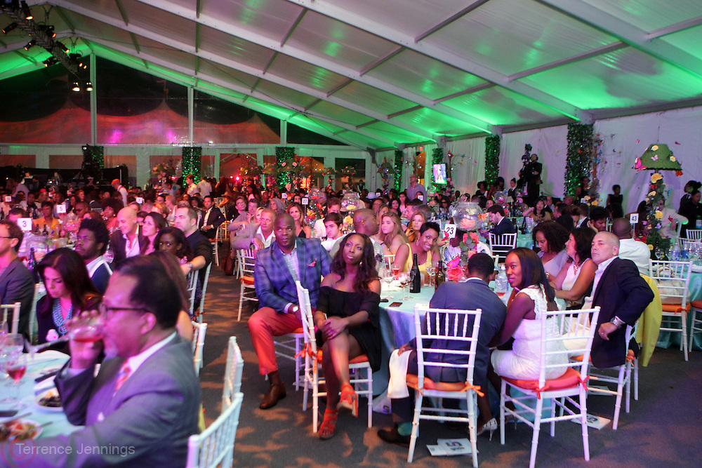 Water Mill, New York: Audience attends the RUSH Philanthropic Arts Foundation 15th Annual Art For Life Benefit Gala held in the Hamptons at the Farmview Farms on July 26, 2014  in Water Mill, New York. (Terrence Jennings)