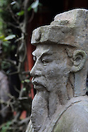 A statue in a restaurant  in Hue, Vietnam, Photograph by Dennis Brack