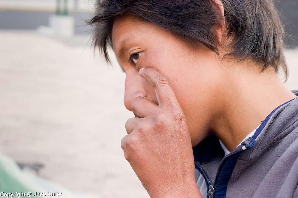 15 SEPTEMBER 2005 - MEXICO CITY: A street teen in Mexico City snorts inhalants. By one estimate there are more than 5000 teenagers living on the streets of Mexico City. PHOTO BY JACK KURTZ