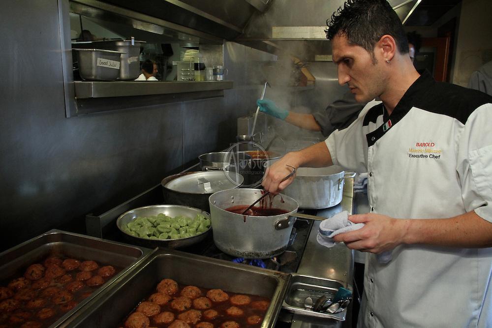 Allegrini Palazzo Della Torre's Cook-Off for a Cause at La Spiga restaurant in Seattle, WA.  Maurizio Milazzo, Executive Chef at Barolo working on his winning entry, Polpettine di Coniglio.