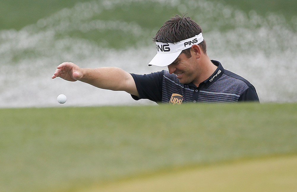 Louis Oosthuizen drops his ball on the fringe of the 18th green in the Shell Houston Open-Round 1 at the Golf Club of Houston on Wednesday, March 31, 2016 in Humble, TX. (Photo: Thomas B. Shea/For the Chronicle)