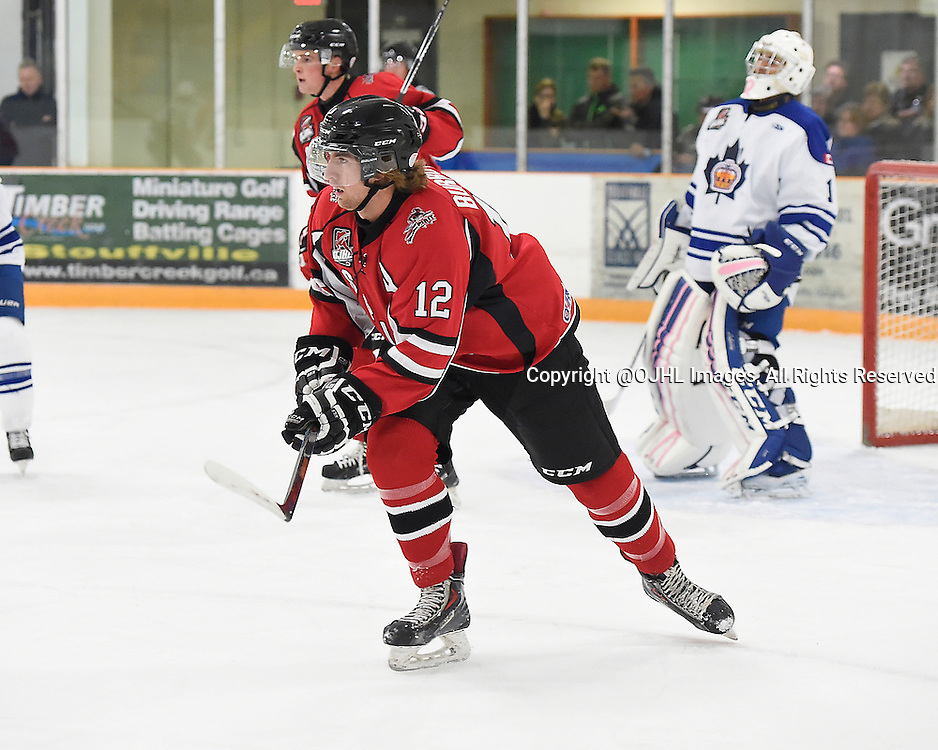 STOUFFVILLE, ON - Oct 3, 2015 : Ontario Junior Hockey League game action between Markham and Stouffville, Rory Milne #12 of the Cobourg Cougars pursues the play during the first period.<br /> (Photo by Andy Corneau / OJHL Images)