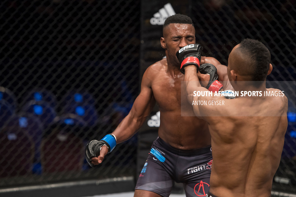 JOHANNESBURG, SOUTH AFRICA - MAY 13: (L-R) TC Khusu and Guy Mongambi in action during EFC 59 Fight Night at Carnival City on May 13, 2017 in Johannesburg, South Africa. (Photo by Anton Geyser/EFC Worldwide/Gallo Images)