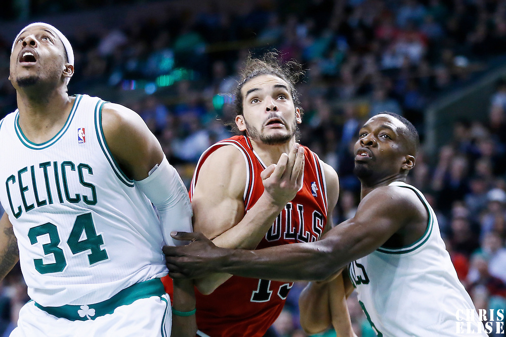 13 February 2013: Chicago Bulls center Joakim Noah (13) vies for the rebound with Boston Celtics power forward Jeff Green (8) and Boston Celtics small forward Paul Pierce (34) during the Boston Celtics 71-69 victory over the Chicago Bulls at the TD Garden, Boston, Massachusetts, USA.