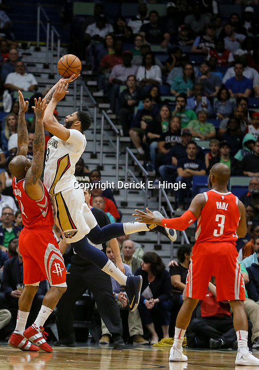 Mar 17, 2018; New Orleans, LA, USA; New Orleans Pelicans forward Anthony Davis (23) shoots over Houston Rockets forward PJ Tucker (4) during the first quarter at the Smoothie King Center. Mandatory Credit: Derick E. Hingle-USA TODAY Sports
