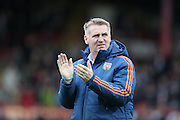 Brentford head coach (Manager) Dean Smith applauding during the Sky Bet Championship match between Brentford and Brighton and Hove Albion at Griffin Park, London, England on 26 December 2015.
