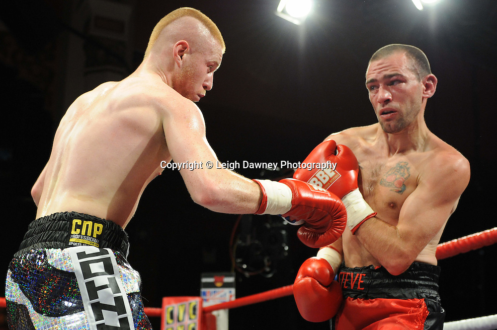 John Quigley (black/silver shorts)defeats Steve Gethin in a Super Featherweight contest at Olympia, Liverpool on the 11th June 2011. Frank Maloney Promotions.Photo credit: Leigh Dawney 2011