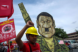 July 24, 2017 - Philippines - A protester pulls a caricature of President Rodrigo Duterte during a rally coinciding President Rodrigo Duterte's annual State of the Nation Address in Quezon City, northeast of Manila, Philippines on Monday, July 24, 2017. President Rodrigo Duterte spoke to protesters outside the House of Representatives after delivering his State of the Nation Address speech, which lasted for more than two hours. (Credit Image: © Richard James M. Mendoza/Pacific Press via ZUMA Wire)