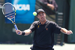 May 24, 2011; Stanford, CA, USA;  Southern California number 2 doubles player Steve Johnson hits a volley against the Virginia Cavaliers during the finals of the men's team 2011 NCAA Tennis Championships at the Taube Tennis Center.
