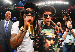 LAS VEGAS, NV - MAY 3: Canadian pop musician Justin Bieber (right) and American rapper Lil' Wayne (left) in the ring before the start of the fight between Floyd Mayweather Jr. and Marcos Maidana at the MGM Grand Garden Arena on May 3, 2014 in Las Vegas, Nevada. (Photo by Ed Mulholland/Golden Boy/Golden Boy via Getty Images) *** Local Caption ***Justin Bieber