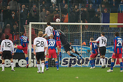 BUCHAREST, ROMANIA - Thursday, December 2, 2010: Liverpool's Sotirios Kyrgiakos his the crossbar with a header during the UEFA Europa League Group K match against FC Steaua Bucuresti at the Stadionul Steaua. (Pic by: David Rawcliffe/Propaganda)