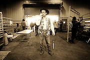 Sweetwater Jaycee Hank Waldrop, of Sweetwater, Texas stands guard, preventing visitors to the 48th annual Worlds Largest Rattlesnake Round-up from going behind the snake pits where the snake hunters bring in their catch, at the Nolan County Coliseum in Sweetwater, Texas, on Friday, March 10, 2006. Waldrop has stood his annual post for over 10 years, regulating who is allowed in and out of the collection area.