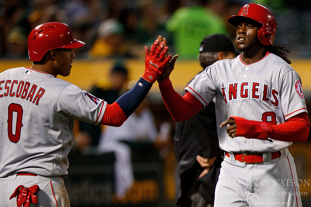 OAKLAND, CA - APRIL 04:  Cameron Maybin #9 of the Los Angeles Angels of Anaheim and Yunel Escobar #0 celebrate after scoring runs on a single by Martin Maldonado (not pictured) during the second inning against the Oakland Athletics at the Oakland Coliseum on April 4, 2017 in Oakland, California. (Photo by Jason O. Watson/Getty Images) *** Local Caption *** Cameron Maybin; Yunel Escobar