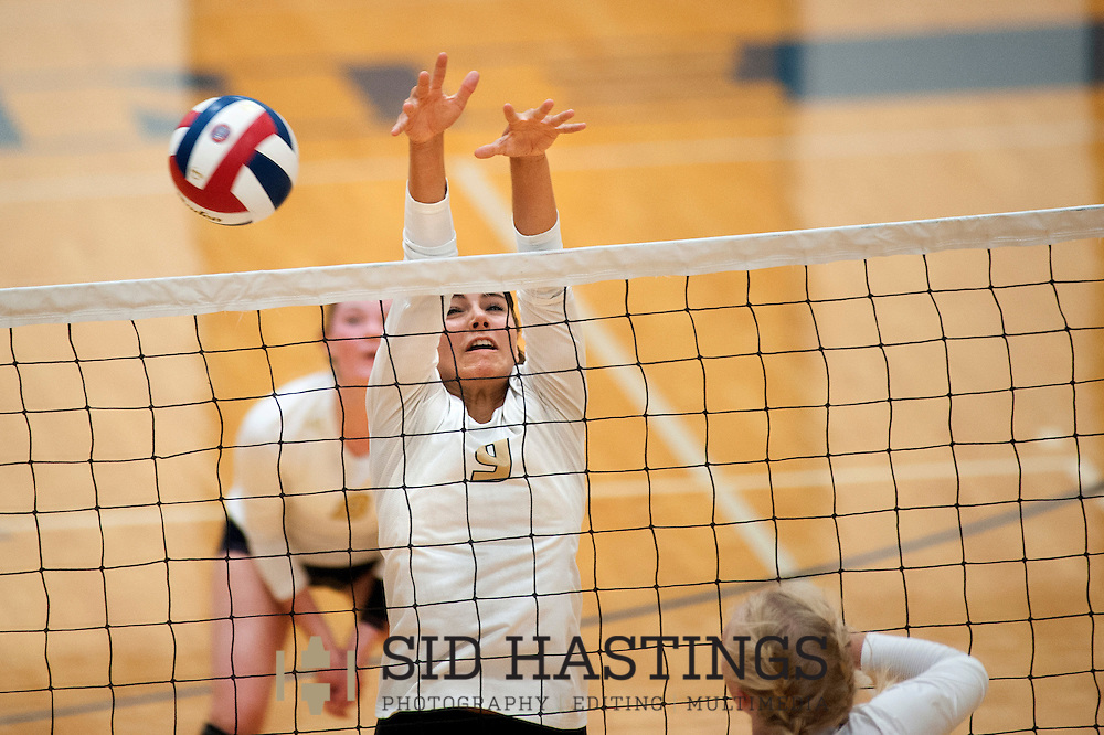 25 AUG. 2015 -- ST. CHARLES, Mo. -- St. Pius X High School volleyball player Jena Otec (9) leaps to block a shot by a Duchesne High School player during the match between the two schools at Duchesne in St. Charles, Mo. Tuesday, Aug. 25, 2015. St. Pius won, 2-0 (25-14, 25-23), to advance to 6-0. It was Duchesne's first match, dropping them to 0-1 on the year. Photo © copyright Sid Hastings.
