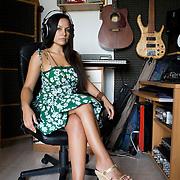 Casarile (Milano), Italy, June 29th, 2011. Maria Angelica Echeverria Muñoz, who was born in Colombia in Bogota in 1983, is in Italy since 1996. She's the winner of MoneyGram's Award 2011 for young entrepreneurs. In 2008 she founded her own record label, the 'Blue Sound Estudios' spreading Latin American music. The company consists of 12 employees and had launched some of the major hits of Bachata music. The company designs and produces music broadcast throughout Europe, with collaborations with international singers of high standard....Casarile (Milano), Italia, 29 giugno 2011. Maria Angelica Echeverria Muñoz, nata in Colombia a Bogotà nel 1983, è in Italia dal 1996. E'vincitrice del MoneyGram Award per la Giovane imprenditoria. Nel 2008 ha fondato la propria casa discografica, la 'Blue Sound Estudios' che diffonde la musica latino americana. L'azienda si compone di 12 dipendenti e al suo attivo ha alcune delle principali hit della musica Bachata. La società progetta e produce prodotti musicali trasmessi in tutta Europa, con collaborazioni con cantanti internazionali di alto livello.