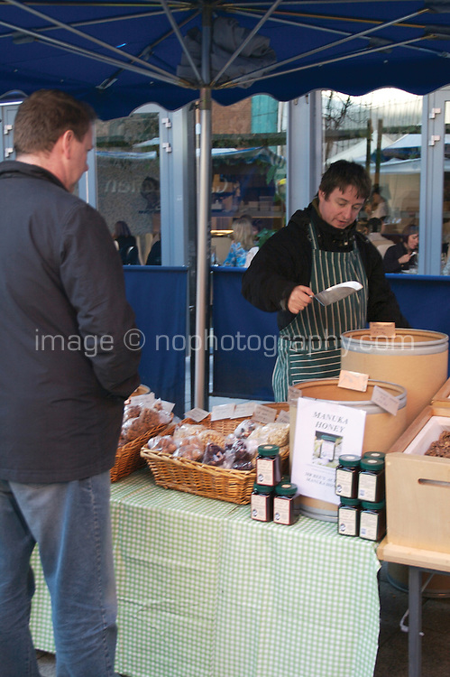 Trader selling nuts at the Temple Bar food market in Dublin Ireland