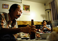 NEW ORLEANS, LA- June 22:  (L-R)  Dung Nguyen drinks a beer after getting a call about a cancelled shrimp boat job.... The Nguyens', a Vietnamese fishing family, at home in east New Orleans, New Orleans, Louisiana, Tuesday June 22, 2010.  Dung Nguyen, the father, has been unable to work on the shrimp boat since the spill, and has had to apply for assistance and train for oil spill clean up work. (Melina Mara/The Washington Post)
