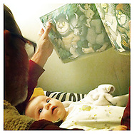 """Craig reads his favorite children's book, """"Where the Wild Things Are,"""" to newborn Quinn. Quinn was fascinated."""