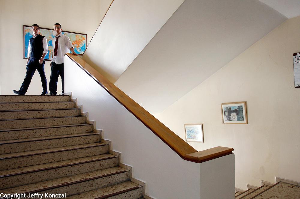 Students walk down a flight of stair at a school in Ankara, Turkey.