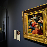 """VENICE, ITALY - NOVEMBER 23:  The painting """"Madonna con Bambino"""" by Lotto is seen next to a sculpture of the XV century by Desiderio da Settignano at the press preview of Tribute to Lorenzo Lotto - The Hermitage Paintings at Accademia Gallery on November 23, 2011 in Venice, Italy. The exhibition which includes two very rare & never seen before paintings opens from the 24th November 2011 to 26th February 2012 in Italy."""