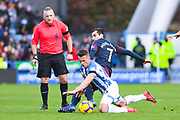 Jonathan Moss (Referee) watches Jonathan Hogg of Huddersfield Town (6) and Henrikh Mkhitaryan of Arsenal (7) tackle each other during the Premier League match between Huddersfield Town and Arsenal at the John Smiths Stadium, Huddersfield, England on 9 February 2019.