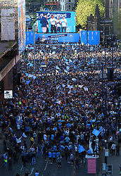 The Manchester City players and staff on stage during the trophy parade in Manchester.