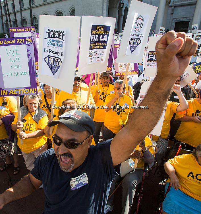 Members of the Fix LA coalition take part in a march and rally in downtown Los Angeles Tuesday, October. 28, 2014. The Fix LA coalition, as they describe themselves, calls on city officials to establish job creation programs, institute a $15 minimum wage, place crossing guards at every school, and stop burdening taxpayers with bank foreclosure costs, organizers say.(Photo by Ringo Chiu/PHOTOFORMULA.com)