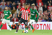 Southampton defender Ryan Bertrand (21) takes on Brighton and Hove Albion midfielder Yves Bissouma (8) during the Premier League match between Southampton and Brighton and Hove Albion at the St Mary's Stadium, Southampton, England on 17 September 2018.