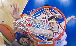 Pau Gasol of Spain vs Omer Asik of Turkey during the EuroBasket 2009 Group F match between Spain and Turkey, on September 12, 2009 in Arena Lodz, Hala Sportowa, Lodz, Poland.  (Photo by Vid Ponikvar / Sportida)