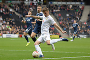 Milton Keynes Dons midfielder Ryan Colclough (49) crosses during the EFL Sky Bet League 1 match between Milton Keynes Dons and Southend United at stadium:mk, Milton Keynes, England on 22 October 2016. Photo by Dennis Goodwin.