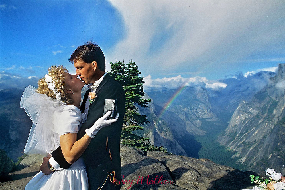 Susan and David Nord, newlyweds from Michigan seal their love with a kiss at Glacier Point in Yosemite National Park, September 17, 1993.  The ceremony was performed by the Hon. Judge Don Pitts, ret. who was the Federal Magistrate in the park.