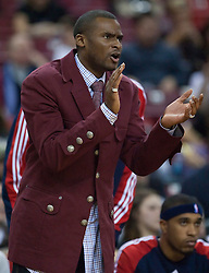 November 27, 2009; Sacramento, CA, USA;  New Jersey Nets guard Keyon Dooling (55) cheers his team from the bench during the third quarter against the Sacramento Kings at the ARCO Arena. Sacramento defeated New Jersey 109-96.