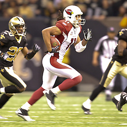 16 January 2010: Arizona Cardinals wide receiver Larry Fitzgerald (11) runs away from New Orleans Saints cornerback Randall Gay (20) and safety Roman Harper (41) during a 45-14 win by the New Orleans Saints over the Arizona Cardinals in a 2010 NFC Divisional Playoff game at the Louisiana Superdome in New Orleans, Louisiana.
