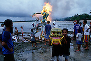 "End of Nyepi (Balinese New Year) Festival..An ""Ogoh-Ogoh"" waiting to be burned after the parade...On Nyepi day, evil spirits descend to see wether the island is inhabited by humans. That's why nobody is allowed to leave the house on that day: when the demons don't find anyone, they leave the island alone for another year. Tourists are confined to their hotels, the use of cars is forbidden and, since 2000, even international air traffic is banned..On the eve of Nyepi however, a great ""Pratima"" (town meeting) is held on Denpasar's Puputan Square, complete with Hindu rituals and offerings to the gods. After sunset, huge cardboard monster puppets called ""Ogoh-Ogoh"" mounted on bamboo grids are carried in a loud and vivid parade around town by groups of young men, before they are burnt."