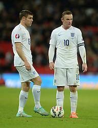 Wayne Rooney of England (Manchester United) and Phil Jagielka of England (Everton)- Photo mandatory by-line: Alex James/JMP - Mobile: 07966 386802 - 15/11/2014 - SPORT - Football - London - Wembley - England v Slovenia - EURO 2016 Qualifier
