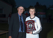 24/05/2017 - Ewan Faulkner was presented with the Lee Walker Man of the Match Trophy by Dundee Schools FA Secretary Grenville Dawson - Grove (white) v Morgan (blue) in the Senior Johnston Trophy Final at Whitton Park, Picture by David Young -