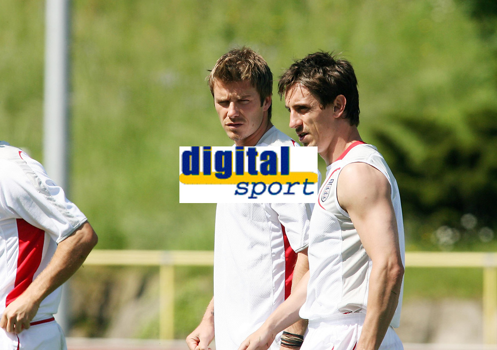 Photo: Chris Ratcliffe.<br />England training session. 07/06/2006.<br />David Beckham and Gary Neville chat in training.