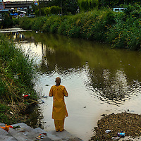 Picture taken on 26 January 2013 showing a Hindu devotee pray near a river during Thaipusam Festival in Kuala Lumpur, Malaysia. Devotees flocked to the temple during the Thaipusam festival, one of the important events in the Hindu calendar, to fulfill their vows and offer thanks to the deities.