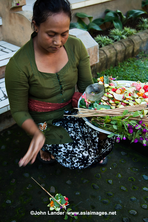 Canang sari are baskets filled with rice and flowers and are offerings that Balinese place at their doorsteps to their Gods three times a day.
