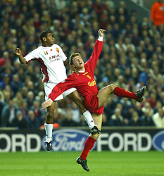 LIVERPOOL, ENGLAND - Tuesday, March 19, 2002: Liverpool's Vladimir Smicer and AS Roma's Aldair during the UEFA Champions League Group B match at Anfield. (Pic by David Rawcliffe/Propaganda)