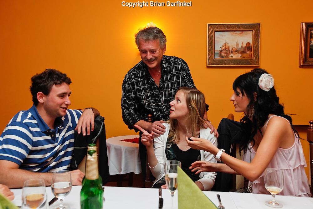Joel, Peter, Eva (Translator), and Eva (Cousin) at dinner in Zilina, Slovakia on Friday July 1st 2011. (Photo by Brian Garfinkel)