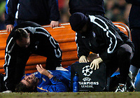 Photo: Richard Lane.<br />Chelsea v Barcelona. UEFA Champions League. 22/02/2006.<br />Chelsea's Joe Cole lies injured, which later sees him having to be substituted.