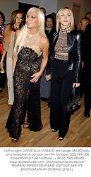 Left to right, DONATELLA VERSACE and singer MADONNA, at a reception in London on 14th October 2002.PEA 308