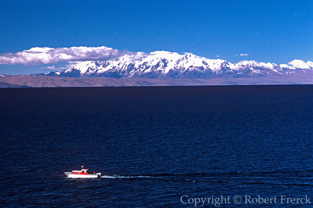 PERU, LAKE TITICACA looking across lake to Bolivia's Eastern Cordillera Range
